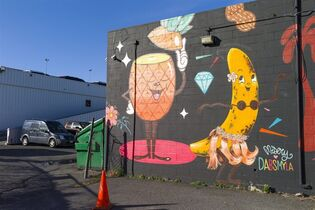 This July 11, 2014 photo shows a mural, a collaboration between New Zealand artist Tanja Jade and Australia artist Dabs Myla, on the wall and alleyway of a car dealership in Kakaako, in Honolulu. Honolulu is famous for golden sand beaches and big waves. But the city's warehouse district, called Kakaako, is famous for its thriving urban arts scene, with colorful street murals so big they stretch across walls and sometimes entire sides of buildings. Honolulu artist Jasper Wong sought to revitalize the area with urban art. Wong created a group called POW!WOW! Hawaii with the goal of beautifying Kakaako and bringing people together through art. Artists from around the globe participated, painting murals on walls across the decaying neighborhood. (AP Photo/Marco Garcia)