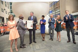 This image released by NBC shows New York Mayor Bill de Blasio, third from left, presenting co-host Al Roker, second left, with a proclamation declaring it Al Roker Appreciation Day during a broadcast of the