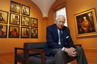 FILE - In this May 13, 2011, file photo, historian and author David McCullough poses with art by George Catlin, one of the artists featured in his new book,
