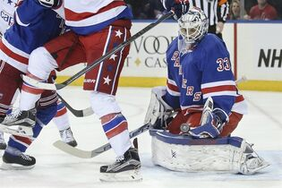 New York Rangers goalie Cam Talbot (33) makes a save during the first period of an NHL hockey game against the Washington Capitals, Sunday, March 29, 2015, in New York. (AP Photo/John Minchillo)