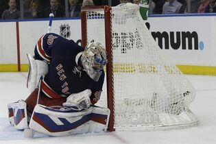 New York Rangers goalie Henrik Lundqvist watches the puck in his the net after Montreal Canadiens left wing Max Pacioretty, scored during the third period of an NHL hockey game Thursday, Jan. 29, 2015 at Madison Square Garden in New York. The Canadiens won 1-0. (AP Photo/Mary Altaffer)