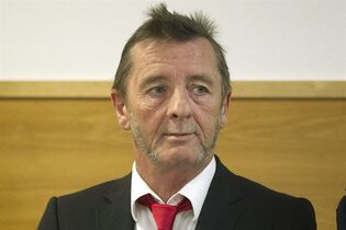 AC/DC drummer Phil Rudd stands in the dock at a court in Tauranga, New Zealand, Tuesday, April 21, 2015. Rudd pleaded guilty to a charge of threatening to kill a man who used to work for him. He also pleaded guilty to possessing methamphetamine and marijuana. (Christine Cornege/New Zealand Herald via AP) NEW ZEALAND OUT, AUSTRALIA OUT