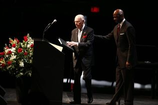 Former Portland Trail Blazers play-by-play announcer Bill Schonely, center, attends the memorial service for Trail Blazers player Jerome Kersey on Monday, March 2, 2015, in Portland, Ore. Kersey died last month. He was 52. (AP Photo/The Oregonian, Bruce Ely)