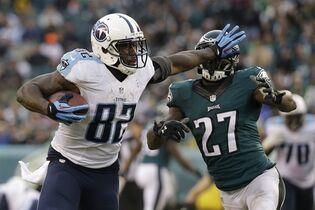 Tennessee Titans' Delanie Walker tries to break free from Philadelphia Eagles' Malcolm Jenkins during the second half of an NFL football game, Sunday, Nov. 23, 2014, in Philadelphia. (AP Photo/Matt Rourke)