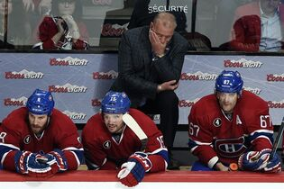 Montreal Canadiens head coach Michel Therrien and players Brandon Prust, left, P.A. Parenteau, center, Max Pacioretty, right, watch the final minutes of their 6-2 loss to the Tampa Bay Lightning during the third period of Game 2 NHL second round playoff hockey action, Sunday, May 3, 2015 in Montreal.THE CANADIAN PRESS/Ryan Remiorz