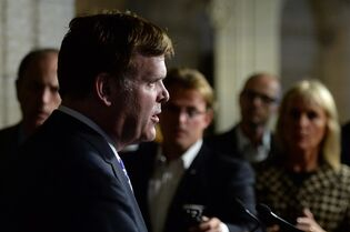 Foreign Affairs Minister John Baird speaks to media in the foyer of the House of Commons in Ottawa, Tuesday, Sept.16, 2014. THE CANADIAN PRESS/Sean Kilpatrick