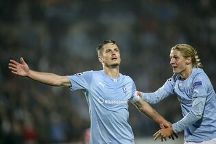 Malmo's double scorer Markus Rosenberg, left, jubilates with Pawel Cibicki, right, after his game-winning goal during their Champions League group A football match Malmo FF vs. Olympiacos FC in Malmo, Sweden Wednesday, Oct. 1, 2014. (AP Photo/TT, Andreas Hillergren) SWEDEN OUT