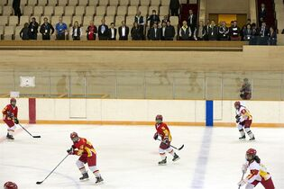 Members of the 2022 Evaluation Commission for the International Olympic Committee (IOC) and representatives of Beijing's 2022 Winter Olympics Bid cCommittee watch members of China's national women's hockey team practice as they tour Capital Indoor Stadium in Beijing, Tuesday, March 24, 2015. (AP Photo/Mark Schiefelbein, Pool)