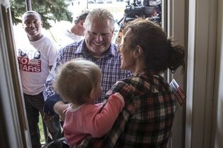 Toronto mayoral candidate Doug Ford (centre) greets Vicki Crystal and her ten-month-old grand daughter Elena as he starts his campaign by door knocking in his local Etobicoke neighbourhood of Toronto on Saturday, September 20, 2014. THE CANADIAN PRESS/Chris Young