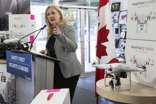 Federal Minister of Transport Lisa Raitt launches the government's campaign for safety awareness for unmanned air vehicles or drones in Toronto on Tuesday October 21 , 2014. THE CANADIAN PRESS/Chris Young