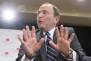 NHL Commissioner Gary Bettman responds to a question from Hockey Night in Canada Host George Stroumboulopoulos as they discuss the launch of the upcoming season at a meeting of The Canadian Club of Toronto, in Toronto on Monday September 22, 2014. THE CANADIAN PRESS/Chris Young