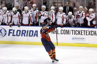 Florida Panthers center Nick Bjugstad (27) celebrates after scoring the game-winning goal in a shootout of an NHL hockey game against the Washington Capitals, in Sunrise, Fla., Tuesday, Dec. 16, 2014. Bjugstad's goal came in the 20th round — on the 40th shot of the shootout, the longest shootout in NHL history. The Panthers won 2-1. (AP Photo/Alan Diaz)