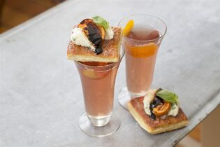 This Dec. 1, 2014 photo shows spiced prosecco and honey broiled persimmon tarts in Concord, N.H. For our bubbles go for Sorel liqueur, which gives the cocktail a gently spiced, lightly fruit flavor. (AP Photo/Matthew Mead)