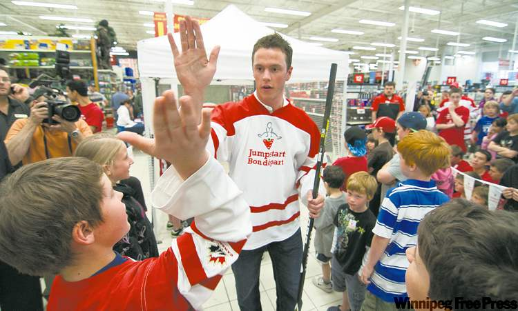 Jonathan Toews high-fives young fans Saturday morning to promote the Jumpstart program.