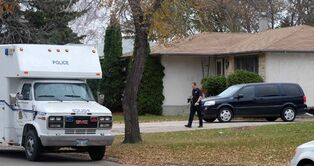 Winnipeg police examine Andrea Giesbrecht's home and garage in the Maples. She is charged with concealing the remains of six infants.