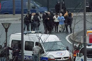 Security officers escort released hostages after they stormed a kosher market to end a hostage situation, Paris, Friday, Jan. 9, 2015.The recent terror attacks in Paris have unleashed a barrage of anti-Muslim and anti-immigrant comments on the Facebook pages of federal politicians and their parties in Canada ??? much of it plainly visible to the public. THE CANADIAN PRESS/ AP/Michel Euler