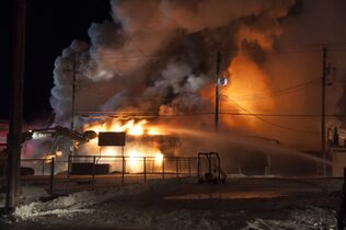 Firefighters battle a blaze that destroyed Neepawa's Home Hardware store.