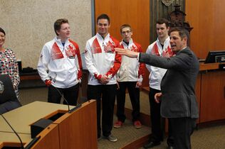 Mayor Brian Bowman presents a sports award to the Canadian Junior Men's curling team. Left to right: Braden Calvert - Skip, Kyle Kurz - Third, Lucas Van Den Bosch - Second, Brendan Wilson - Lead.