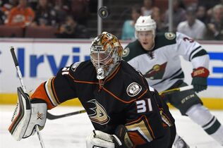 Anaheim Ducks goalie Frederik Andersen, left, of Denmark, blocks a shot as Minnesota Wild center Charlie Coyle watches during the first period an NHL hockey game Friday, Oct. 17, 2014, in Anaheim, Calif. (AP Photo/Mark J. Terrill)