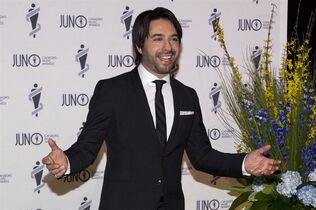 Jian Ghomeshi arrives on the green carpet for the Juno Gala in Winnipeg on Saturday, March 29, 2014. Ghomeshi thanked his supporters Thursday and vowed to meet the allegations against him head-on, a pledge that came as a