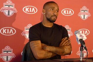 Toronto FC striker Jermain Defoe meets the media at the team's training centre in Toronto on Sept.24, 2014. Unable to do his talking on the pitch, a frustrated Jermain Defoe did some venting Thursday. The Toronto FC star told reporters he may have to undergo an operation because of the persistent groin injury that has kept him out of 10 of the last 14 games. And the 32-year-old England striker says he is upset that people have questioned his commitment to the club and whether he is really injured. THE CANADIAN PRESS/Neil Davidson