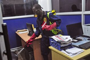 An employee of the Monrovia City Corporation sprays disinfectant inside a government building in Monrovia, Liberia, Friday, Aug. 1, 2014.THE CANADIAN PRESS/AP, Abbas Dulleh