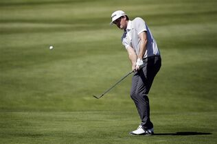 Keegan Bradley chips onto the first green at the Match Play Championship golf tournament Thursday, April 30, 2015, in San Francisco. (AP Photo/Eric Risberg)