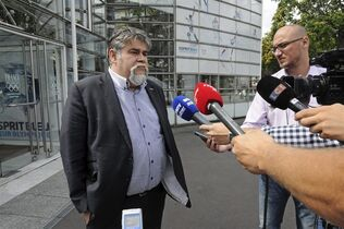 This Wednesday Aug. 20, 2014 photo shows Jerome Ducros, president of Luzenac football club in the French Pyrenees, speaking to reporters after meeting French league officials at an arbitration hearing at the Paris headquarters of the French Olympic Committee. The small club earned promotion from League 3 last season and should now be playing in the professional League 2 but is being refused admittance on administrative grounds, provoking intense debate in France about the impact of money on football. (AP Photo/John Leicester)