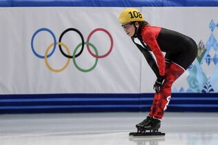 Canada's Marianne St-Gelais catches her breath after failing to qualify in the women's 1,500 metre heats in the short track competition at the Sochi Winter Olympics Saturday, February 15, 2014 in Sochi. THE CANADIAN PRESS/Paul Chiasson