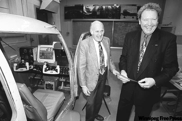 George Elliott (left) is seen accepting a cheque for the aviation museum from  Boeing official Jim Sawyer in this 1999 photo.
