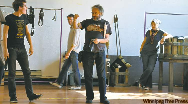 Tobias Hughes as  Hal (left)  and David Warburton as Falstaff, rehearse with Tom Keenan (Poins) and Michelle Boulet (Doll Tearsheet) in background; above, map of the new SIR site.