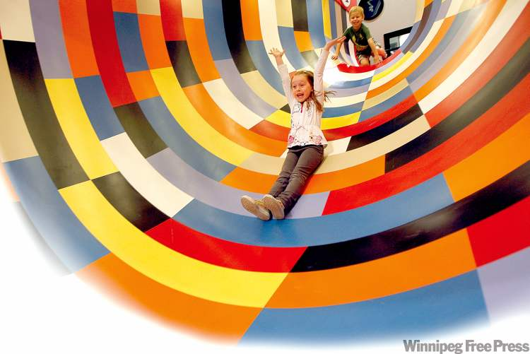 Emily Cox, 6, slides down Illusion Tunnel at the Manitoba Children's Museum.