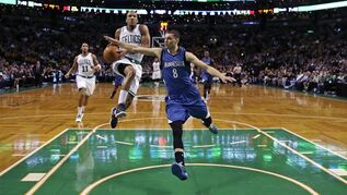 Minnesota Timberwolves guard Zach LaVine (8) tries to stop Boston Celtics guard Avery Bradley, center left, on a drive to the basket during the first quarter of an NBA basketball game in Boston, Friday, Dec. 19, 2014. (AP Photo/Charles Krupa)