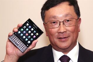 BlackBerry CEO John Chen shows off the new Passport phone after the company's annual general meeting in Waterloo, Ont., Thursday June 19, 2014. BlackBerry is bringing its newest Passport smartphone to the market with a price that's lower than Apple's iPhone 6 and the latest incarnation of the Samsung Galaxy. THE CANADIAN PRESS/Dave Chidley