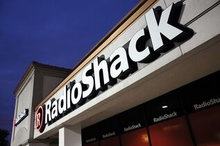 FILE - This Tuesday, Feb. 3, 2015 file photo shows a RadioShack store in Dallas. A bankruptcy judge on Tuesday, March 31, 2015 approved the sale of more than 1,740 RadioShack stores to hedge fund Standard General, preserving some 7,500 jobs. (AP Photo/Tony Gutierrez, File)