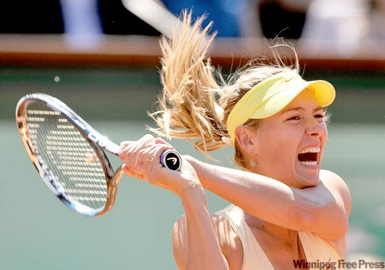 Russia's Maria Sharapova hits a shot against Li Na of China during the women's semifinals at the French Open at Roland Garrros in Paris on Thursday,