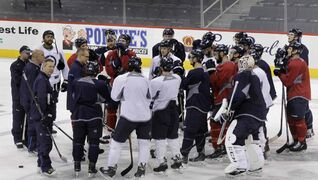 Winnipeg Jets head coach Paul Maurice speaks to players after the pre-game skate Tuesday morning in the MTS Centre. The Jets play the Hurricanes at 7 p.m. Tuesday night.