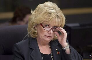 Senator Pamela Wallin, chair of the National Security and Defence committee, adjusts her glasses at the start of a meeting, Monday February 11, 2013 in Ottawa. The RCMP has filed new documents in court alleging Wallin submitted 21 travel expense claims to the Senate in order to claim reimbursement for her private and business trips to Toronto and Guelph. THE CANADIAN PRESS/Adrian Wyld