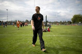 B.C. Lions quarterback Travis Lulay leaves the field following a news conference at the Lions Surrey practice facility in Surrey, B.C. Tuesday, Sept. 9, 2014. Lulay addressed the media regarding a shoulder dislocation similar to the one he suffered last season. THE CANADIAN PRESS/Jonathan Hayward