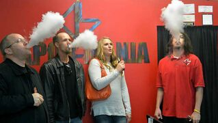 Utah Smoke Free Association executive director Aaron Frazier, members Brian and Deanna Fisher and