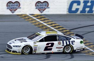 Brad Keselowski crosses the finish line as he wins the NASCAR Sprint Cup series auto race at Chicagoland Speedway in Joliet, Ill., Sunday, Sept. 14, 2014. (AP Photo/Nam Y. Huh)