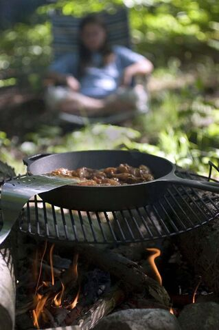 Nothing beats waiting for a meal cooked over open flame at your campsite. (Larry Crowe / The Associated Press files)</p>