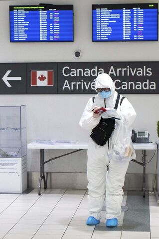 Chris Young / The Canadian Press</p><p>A traveller stands in the international arrivals hall at Toronto's Pearson Airport.</p>