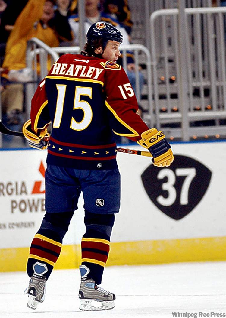 Former Thrasher Dany Heatley skates past teammate Dan Snyder's No. 37 at Philips Arena in Atlanta.