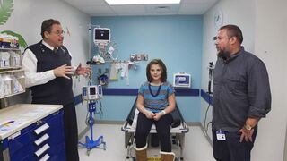 This photo provided by courtesy of HBO shows, from left, Dr. Stephan Grupp, Emily Whitehead, Shane Smith, in a scene from