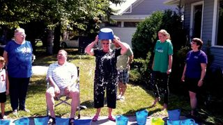 ALS Society of Manitoba executive director Diana Rasmussen soaks herself in ice water.