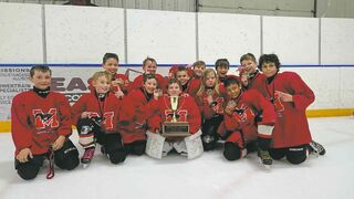 The Southwest Warriors went 8-0 in the Mustangs Charity Hockey Tournament to win the championship title in the nine-year-old division. From left: Rhett Marchant, Dylan Care, Nathan Cockle, Noah Dziver, Marek Mitosinka, Tristan Boak, Porter Holland, Stefan Sdrolias, Reese Unrah, Quinn Magnusson, Tyson MacDonald, Simeon Enns, and Tyson Wilbon.