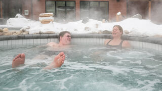 Doug Speirs and Nordik Spa-Nature spokesperson Marianne Trottier in the outdoor hot tub during a quick test run of the thermotherapy (or heat therapy) offered at the brand new Thermea spa on Crescent Drive. After spending time in a dry sauna, clients quickly walk through an ice-cold pool to shock the system, before relaxing in the hot tub, sauna or other relaxation areas.    