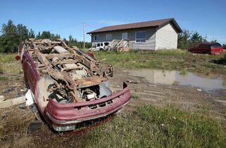 The front yard of a home on the St. Theresa Point First Nation is seen in a file photo.  It's not uncommon to have up to 18 people sharing a three-bedroom bungalow on the reserve, says Chief David McDougall.
