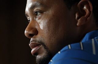 FILE - In this May 19, 2014, file photo, Tiger Woods speaks at a Quicken Loans National PGA tournament media day news conference at Congressional Country Club�in Bethesda, Md. It was five years ago this week that a fire hydrant he struck with his SUV became the symbol of his before-and-after career. (AP Photo/Patrick Semansky, File)